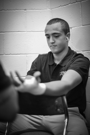 Connor getting strapped up for his fight at Cage Soldiers 3.